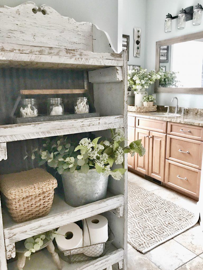vanity and farmhouse shelf in master bathroom