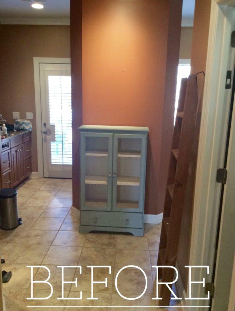 master bathroom before orange wall with blue shelf
