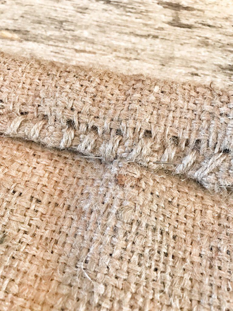 pin in burlap sack close up