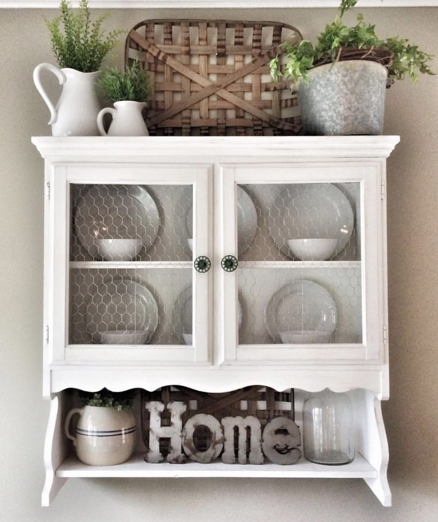 white wooden hutch hung in kitchen after picture