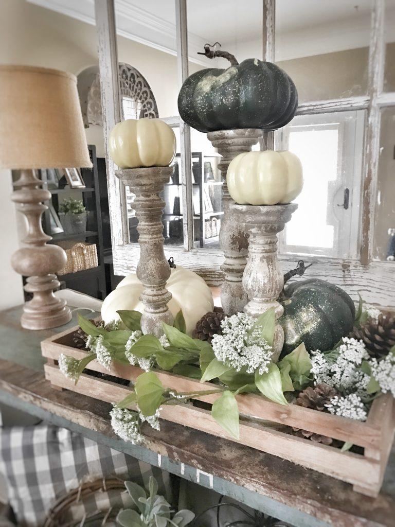 fall decor pumpkins on candlesticks