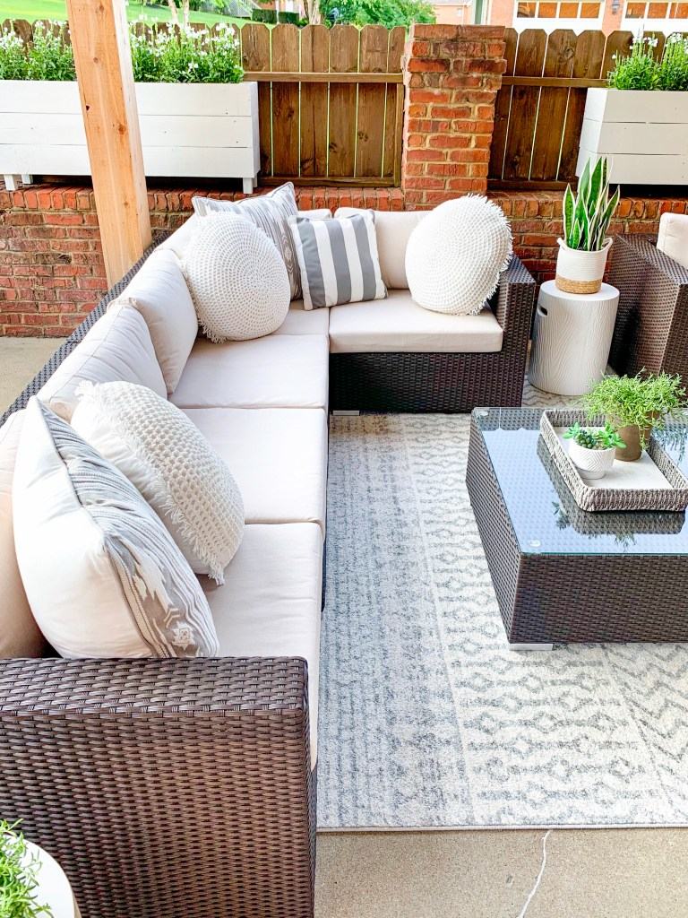 wide view of outdoor sectional with pillows