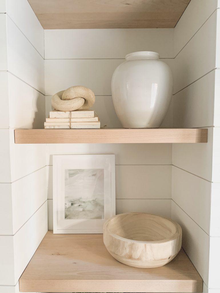 white vase and books on shelf